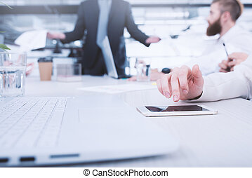 Businesswoman works on a mobile phone. Concept of internet sharing and interconnection