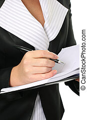Businesswoman write in a notebook
