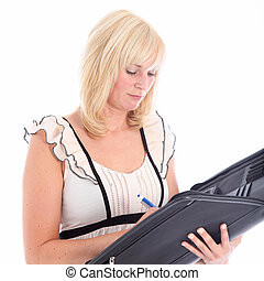 Businesswoman writing in large leather folder