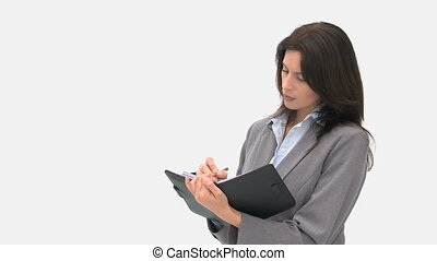 Businesswoman writing on her agenda