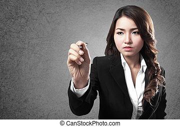 businesswoman writing on screen