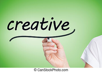 Businesswoman writing the word creative