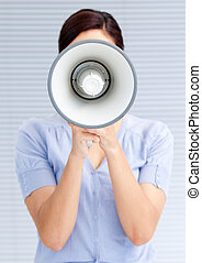 Businesswoman yelling through a megaphone