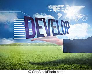Businesswomans hand presenting the word develop