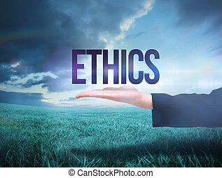 Businesswomans hand presenting the word ethics against blue...