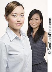 Businesswomen 1 - Two pretty asian businesswoman - one in...