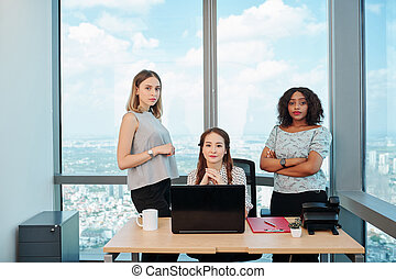 Businesswomen at office desk