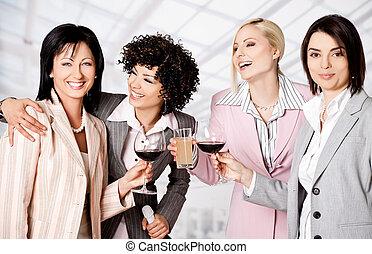 Businesswomen celebrating