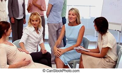Businesswomen chatting on their bre