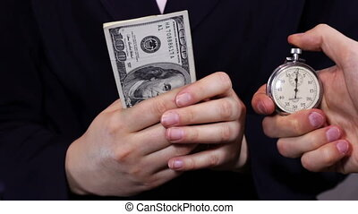 Businesswomen Counts Money and Stopwatch.