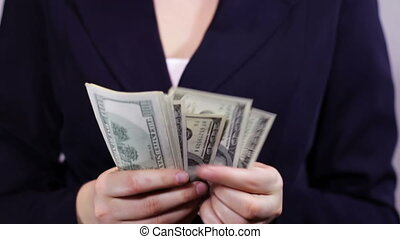Businesswomen Counts Money in Hands.