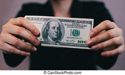 Businesswomen Counts Money in Hands.
