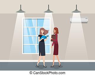 businesswomen couple in corridor office