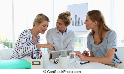 Businesswomen having a meeting usin