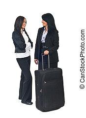 Businesswomen having conversation before travel - Full...