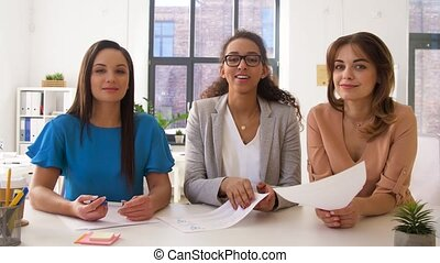 businesswomen having video conference at office