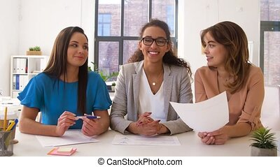 businesswomen having video conference at office - business,...