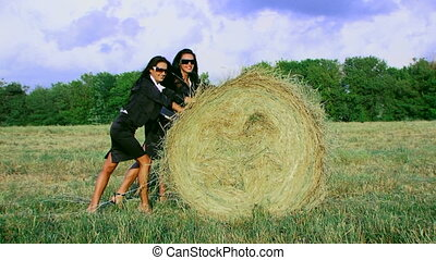 Businesswomen in a field