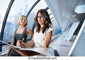 Businesswomen in futuristic interior
