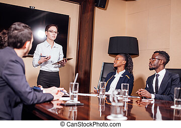 businesswomen interacting at the meeting in modern office -...