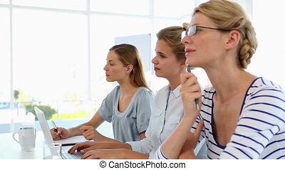 Businesswomen listening to a presen
