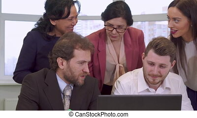 Businesswomen point their hands on laptop screen