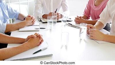 Businesswomen shaking hands at meet