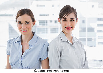 Businesswomen smiling at camera