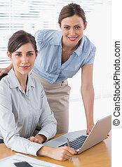 Businesswomen smiling at camera