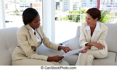 businesswomen talking in a meeting