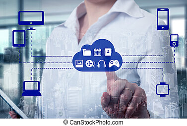Businesswomen touching a cloud connected to many objects on...