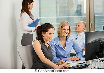 Businesswomen Using Computer In Office