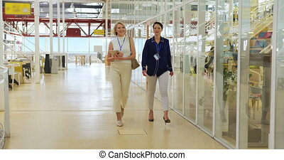 Businesswomen walking at a conference - Front view of two ...