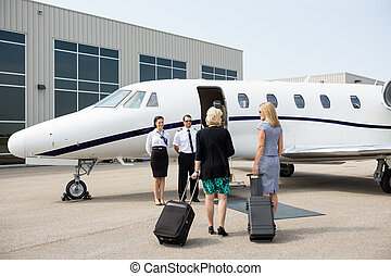 Businesswomen Walking Towards Private Jet