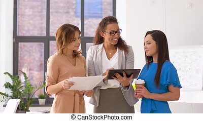 businesswomen with tablet pc and charts at office -...