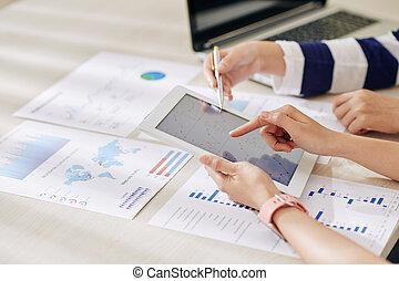 Businesswomen working on annual report