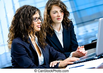 Young businesswomen working on laptop computer in meeting room at office.