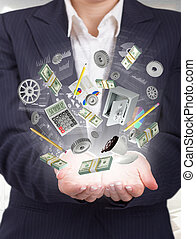 Businnes concept. Woman hand hold elements of business in...