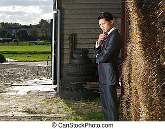 Businnessman in standing pose on the farm