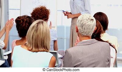 Busnesswomen applauding colleague - Buisnesswomen applauding...