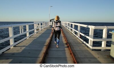 Busselton Jetty enjoying - Carefree young sporty woman at...