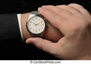 Bussines Time - Business man looking at watch. Black...