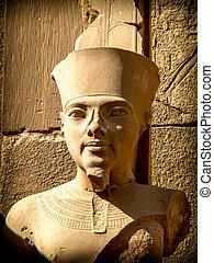 Bust of pharaoh Tutankhamun in Karnak Temple (Luxor, Egypt)...