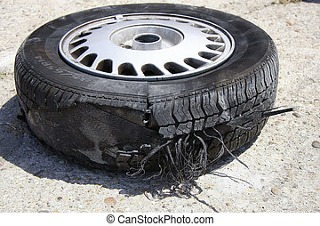 busted wheel - busted wheel on the road after an accident...