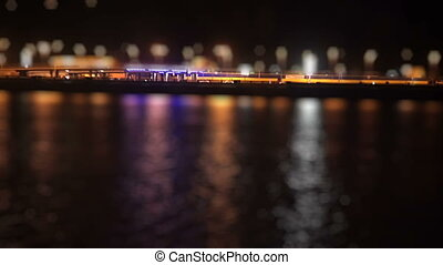 Bustling traffic on the waterfront at night