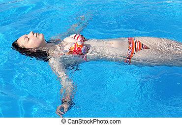 Busty girl in swimming pool
