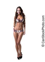 Busty model advertises stylish underwear, isolated on white