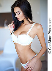 Busty sexy young woman in white lingerie - Beautiful busty...