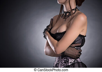 Busty woman in elegant pink and black corset with floral...