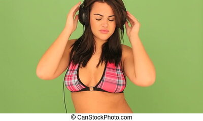 Busty Woman Listening To Music